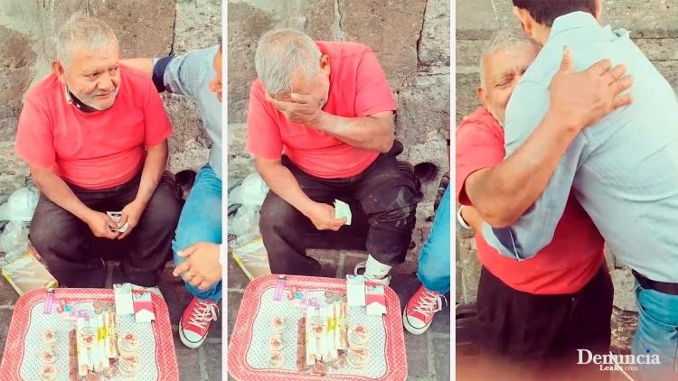 Tento muž seděl na ulici několik hodin a prodával sladkosti. Když k němu přišel neznámý muž, nemohl zadržet slzy